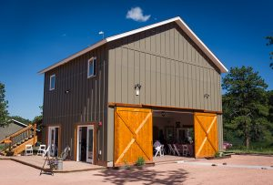 Our Carriage House Venue Building with large barn doors