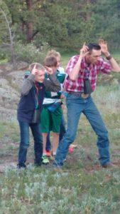 Dude ranch cowboy campfire at affordable all-inclusive colorado family adventure vacation