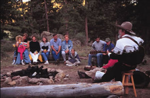Guests sit around the campfire